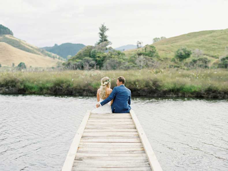 Bride-and-Groom-sitting-on-dock