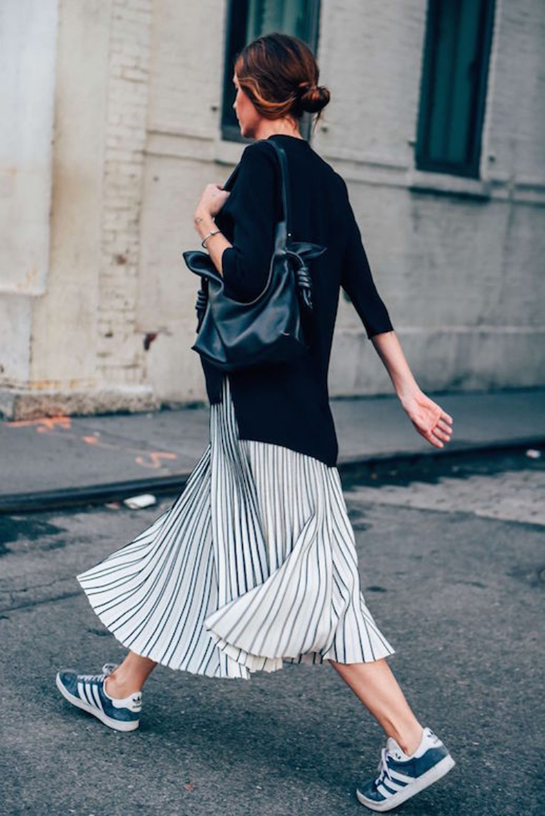 Le-Fashion-Blog-25-Ways-To-Wear-Adidas-Sneakers-Sweater-Stripe-Midi-Skirt-Blue-White-Stripe-Street-Style-Via-Tommy-Ton