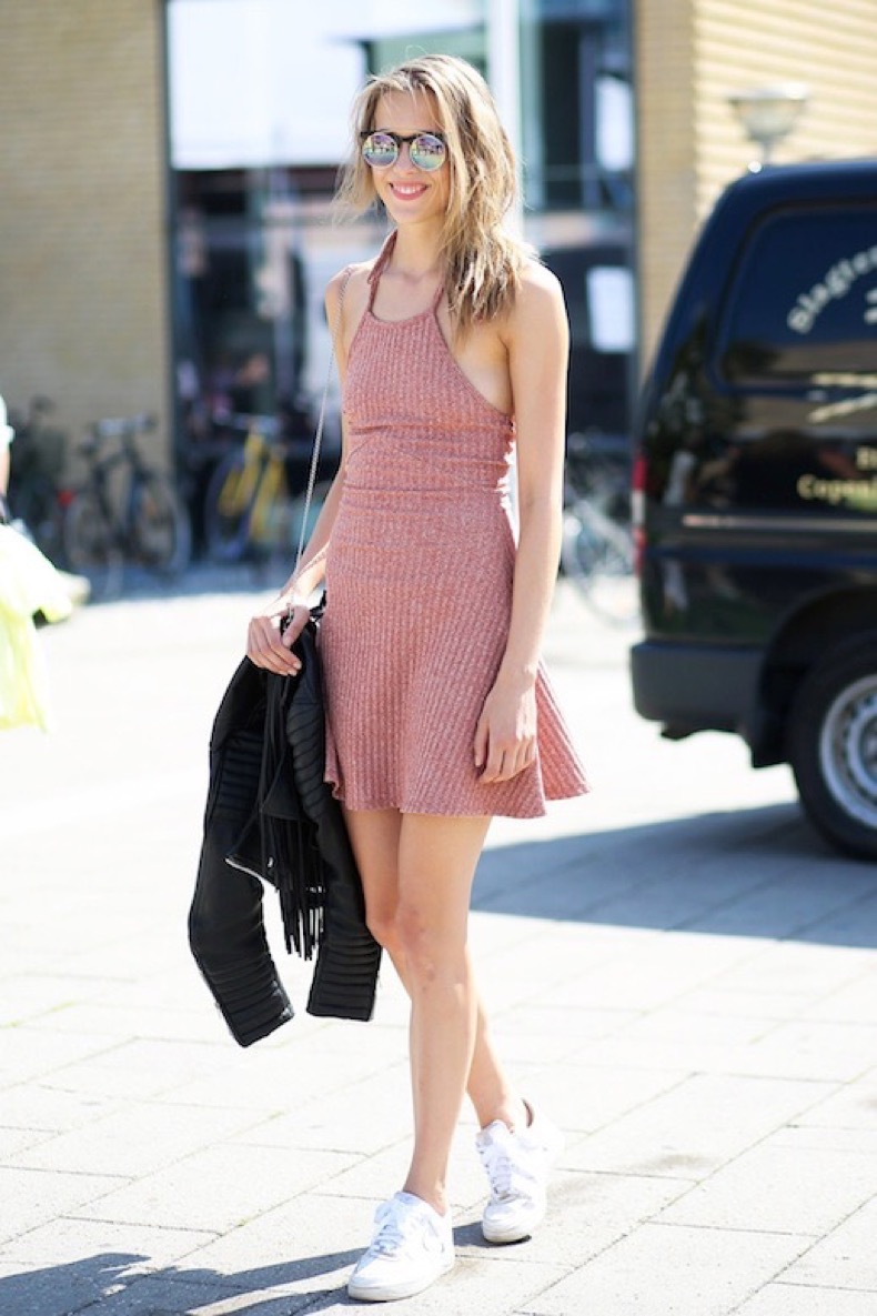 le-fashion-blog-street-style-cfw-casual-ribbed-mini-halter-dress-with-a-flared-skirt-mirrored-sunglasses-white-sneakers-leather-jacket-via-british-vogue